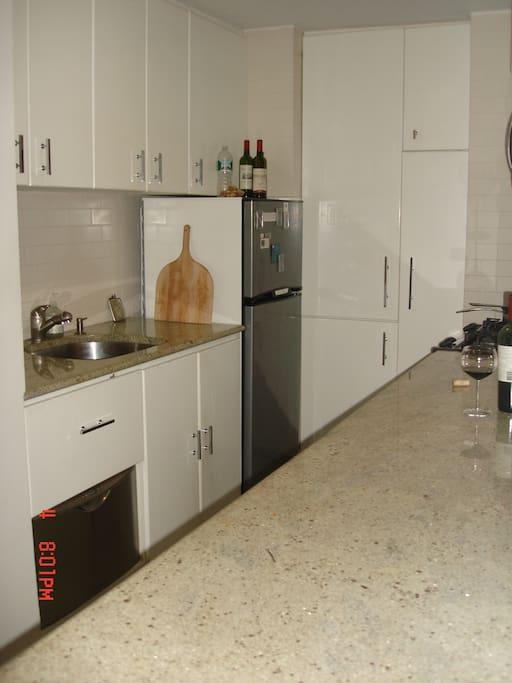 Kitchen - showing sink,  dishwasher, refrigerator and cupboards