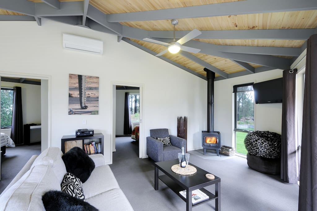 Large open plan living space, log fire & aircon.  2 separate BRs