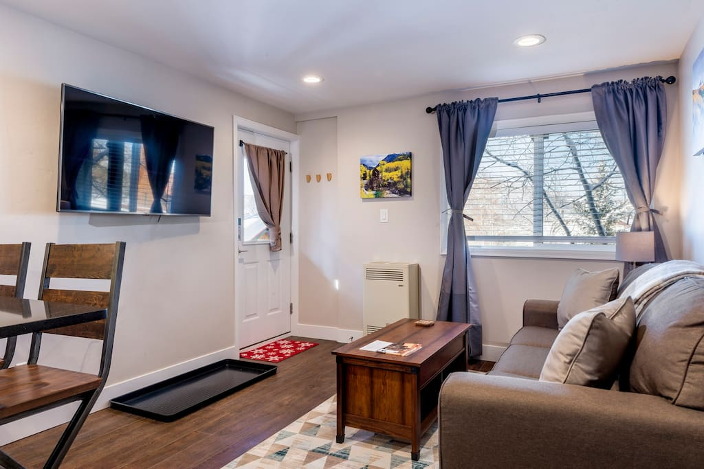 Comfortable living room area leads into kitchen peninsula with quartz countertops. 55'' HD TV with DVD player to relax after a hard day.