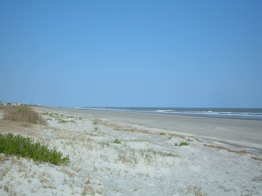 Wide sandy beach on the quiet stretch of the island