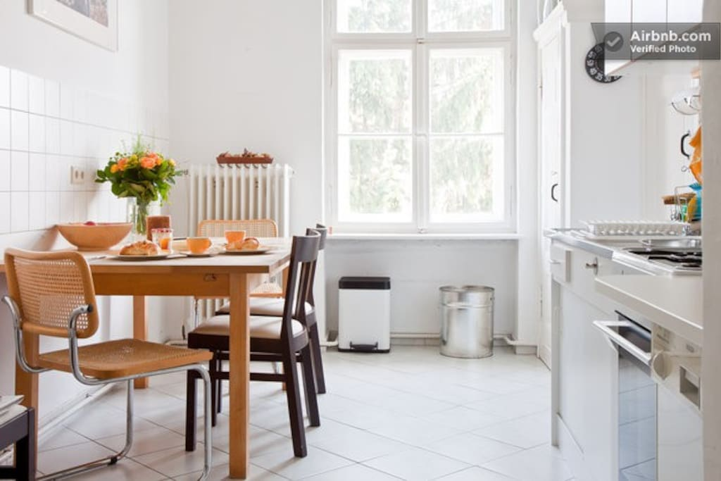 Kitchen – this picture shows the kitchen and the dining table ready for breakfast
