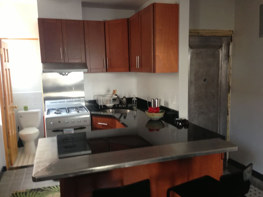 Full kitchen that comfortably seats two. Fridge is under counter.