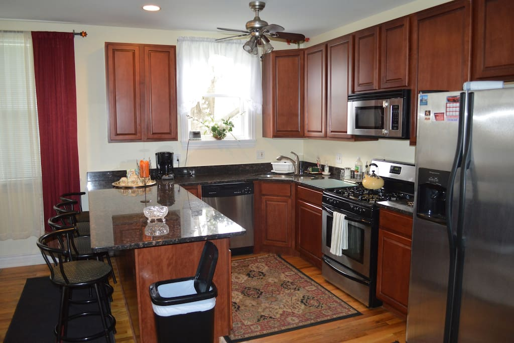 Another view of the kitchen. You may notice we have upgraded to swivel chairs. We continue to improve upon our lovely BnB.