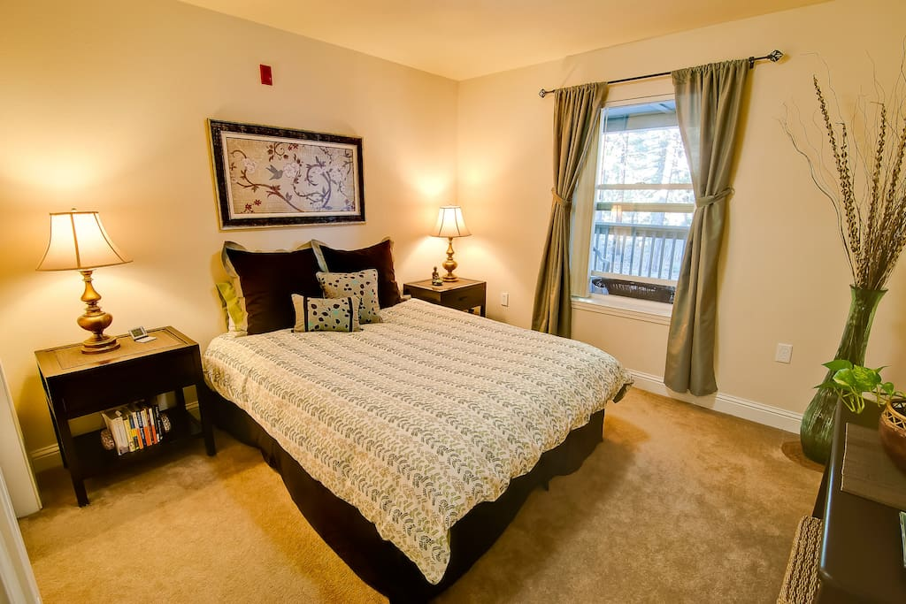 The master bedroom has a  queen size bed and down comforter.