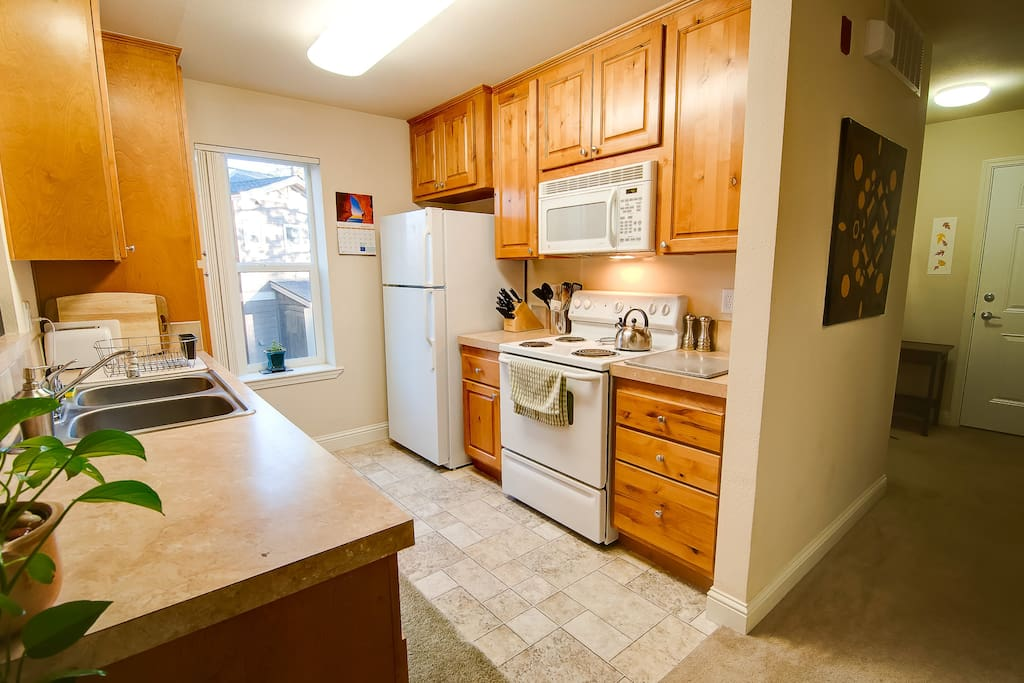Kitchen comes fully equipped with dishes, pots and pans, condiments, microwave, stove, refrigerator and dishwasher.