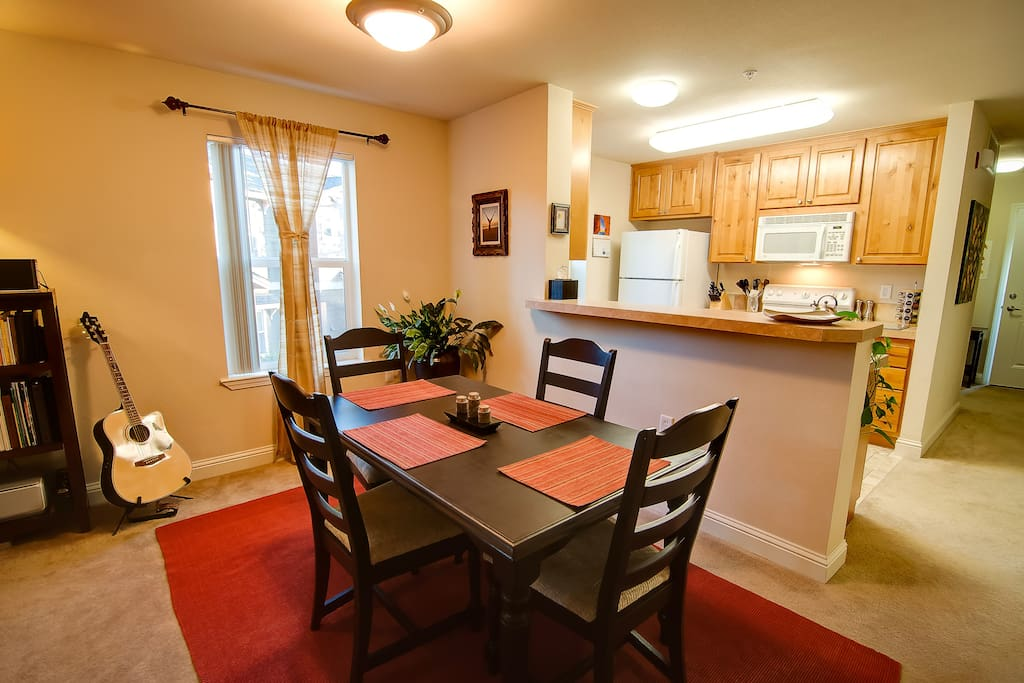 The dining area seats 4 and offers easy access to the kitchen.