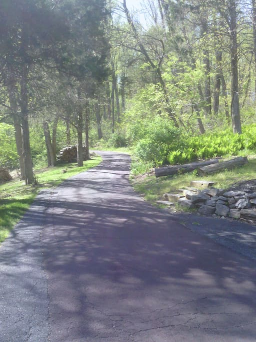 The winding driveway brings you through 23 wooded acres to your Bucks County cottage retreat ...