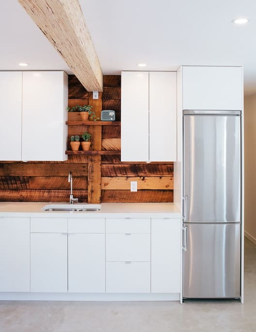 Exposed beam and stainless steel fridge