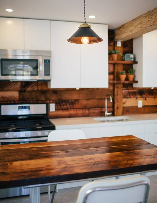 Gas Range and moveable reclaimed wood island