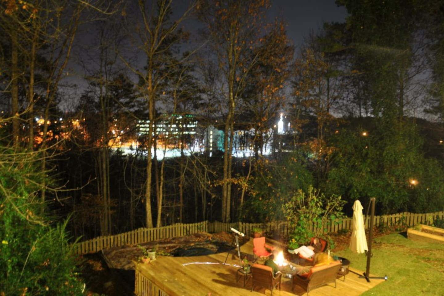 The backyard deck overlooks a business park and Lady Liberty.