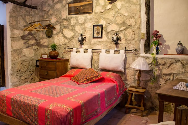 Casitas Kinsol Guest House Room #2 - Stone wall under a stucco roof with skylights to watch the moon from your bed -