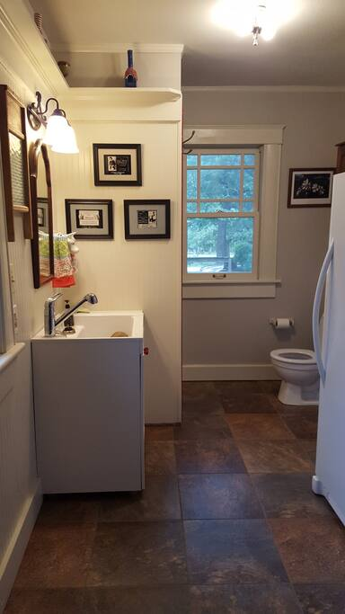 Full bath directly off of bedroom with ample natural light and laundry access.
