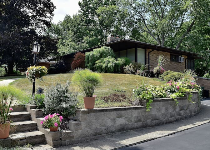 Fairly attractive hilltop entrance and curbside appeal with grand staircase effect retaining walls