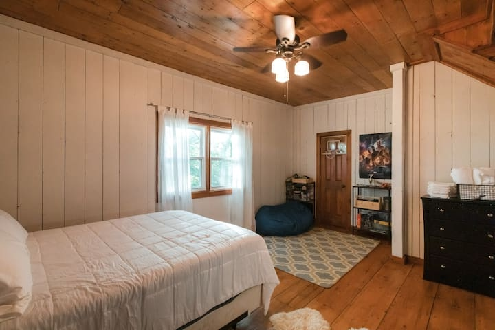 2nd Bedroom. Large space with queen bed and closet with dresser.