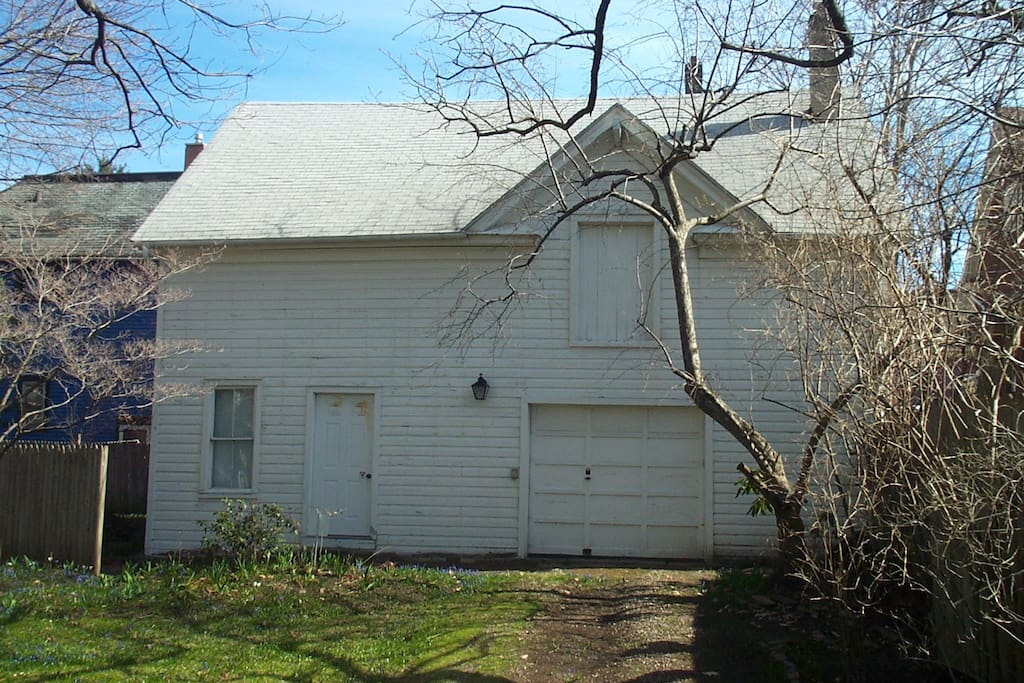 the carriage house at the back corner of the property