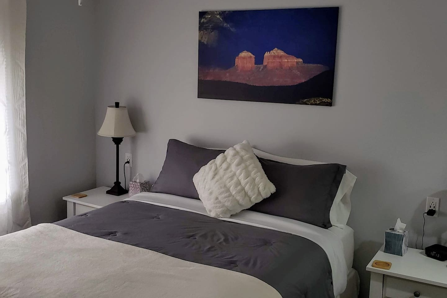 Peaceful rest ~ Guest bedroom has nightstands, chest of drawers, upholstered chair, and a desk and chair! TV with local channels + Netflix and Amazon Prime movies (no cable).  Your own private bathroom is off of the shared hallway. Enjoy!