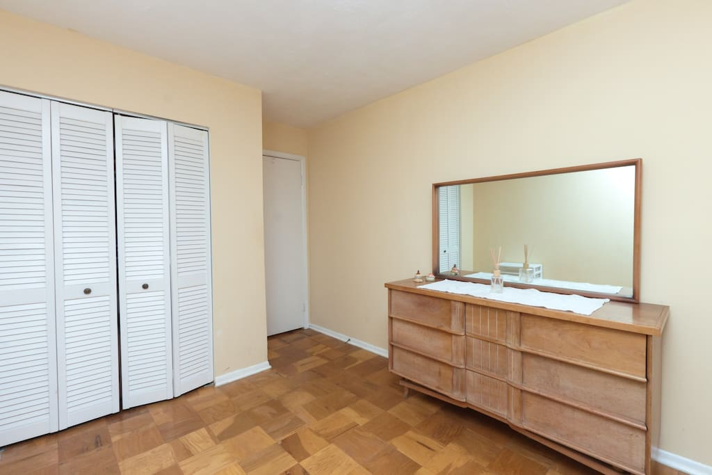 Large closets in the Twin room with extra pillows, blankets, and towels for guests. .