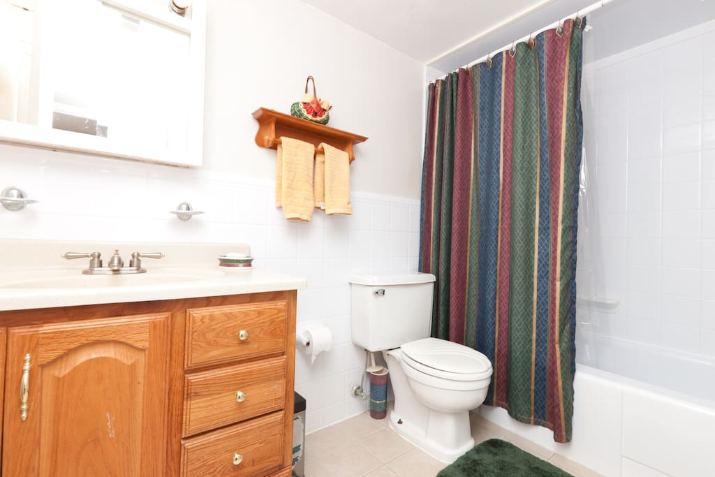 The shared bath has a full tub and shower.
