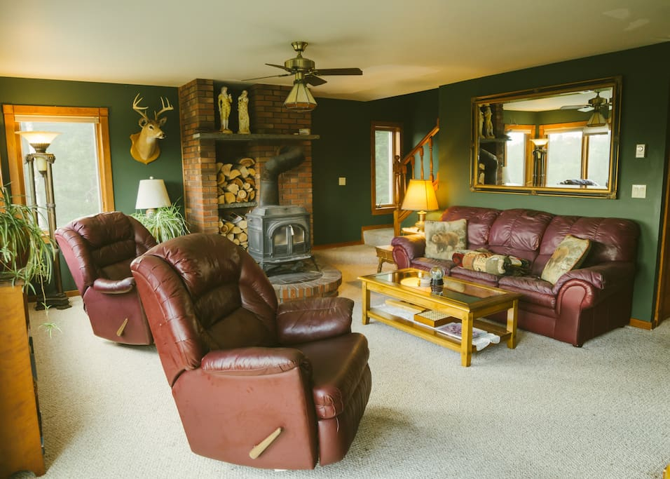 Open concept living room and kitchen with room for the whole family! Including a woodstove to cozy up to after a long day on the slopes:)