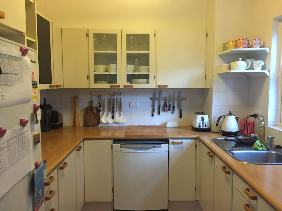 Compact kitchen with microwave oven to boot.