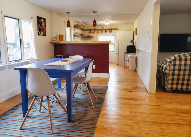 The open floor plan dining area is light and spacious and the table is large enough for family meals and board games.