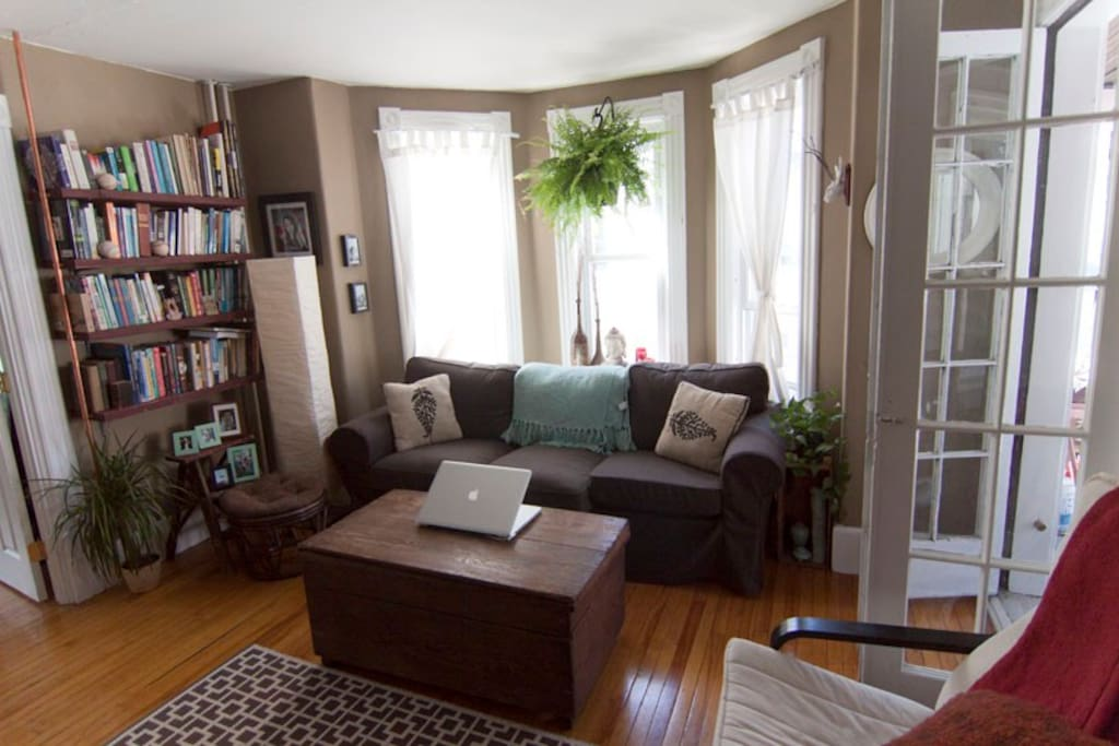 living room with wall mounted 46; inch; HD TV and netflix. Lots of windows and bright sun