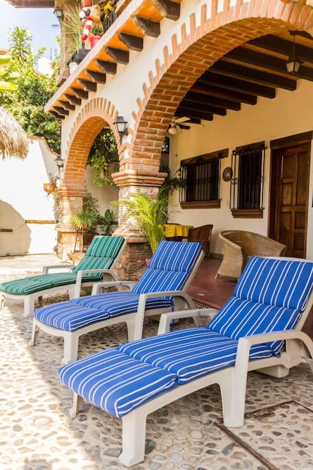 Poolside seating outside the Villa Studio