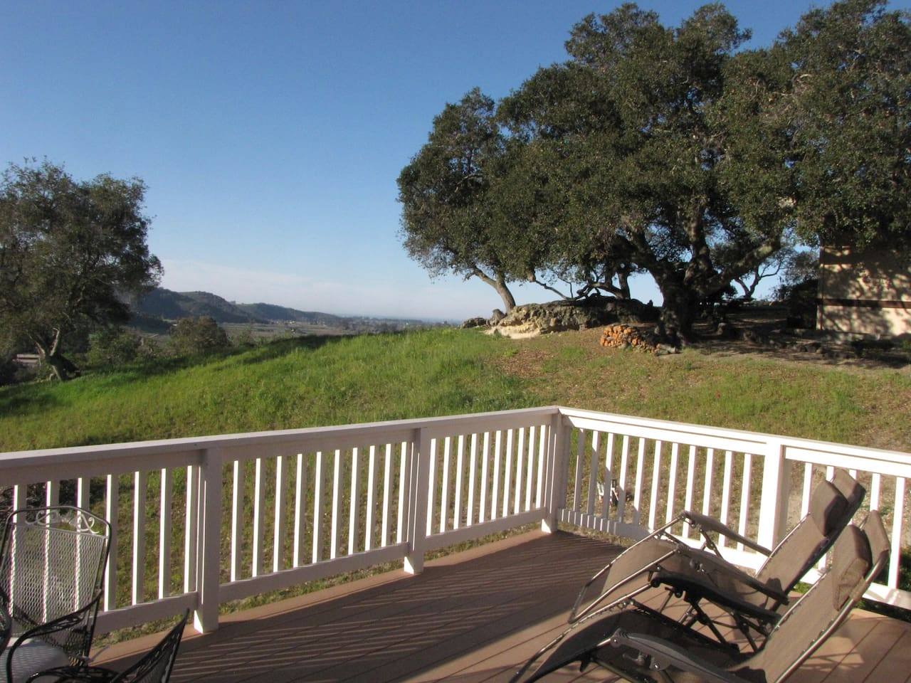 Enjoy morning coffee or evening wine on your private deck with ocean view!