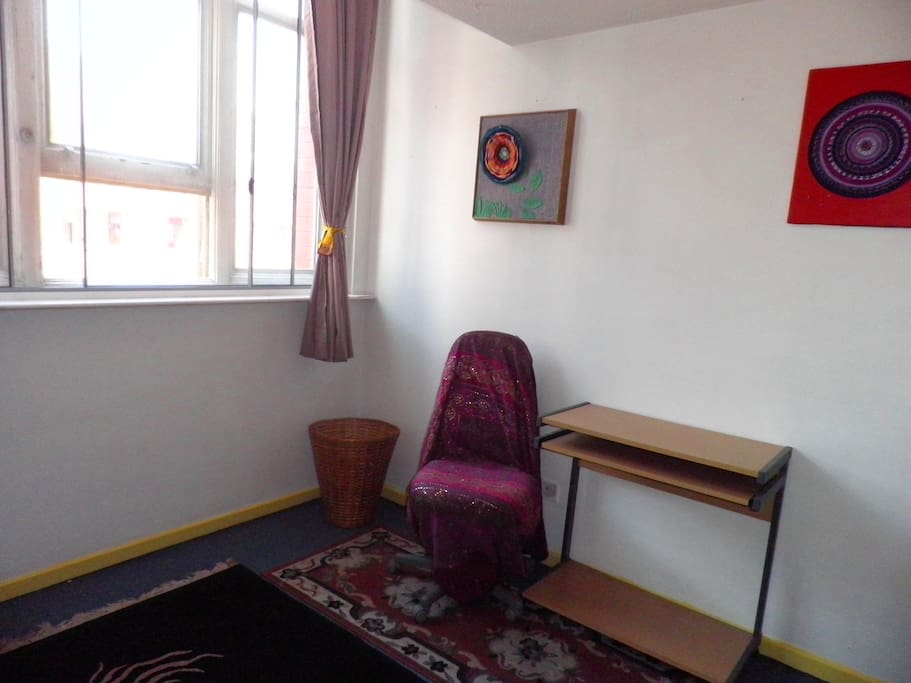 spare bedroom, desk, chair and light