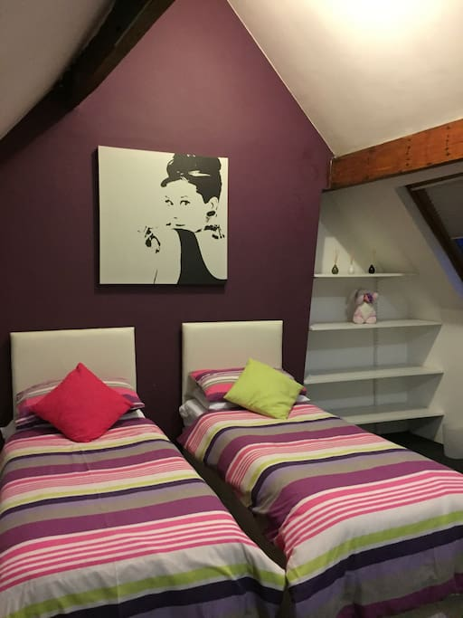 Top Floor Bedroom - zip & link beds can be made as singles or double. Travel cot available.