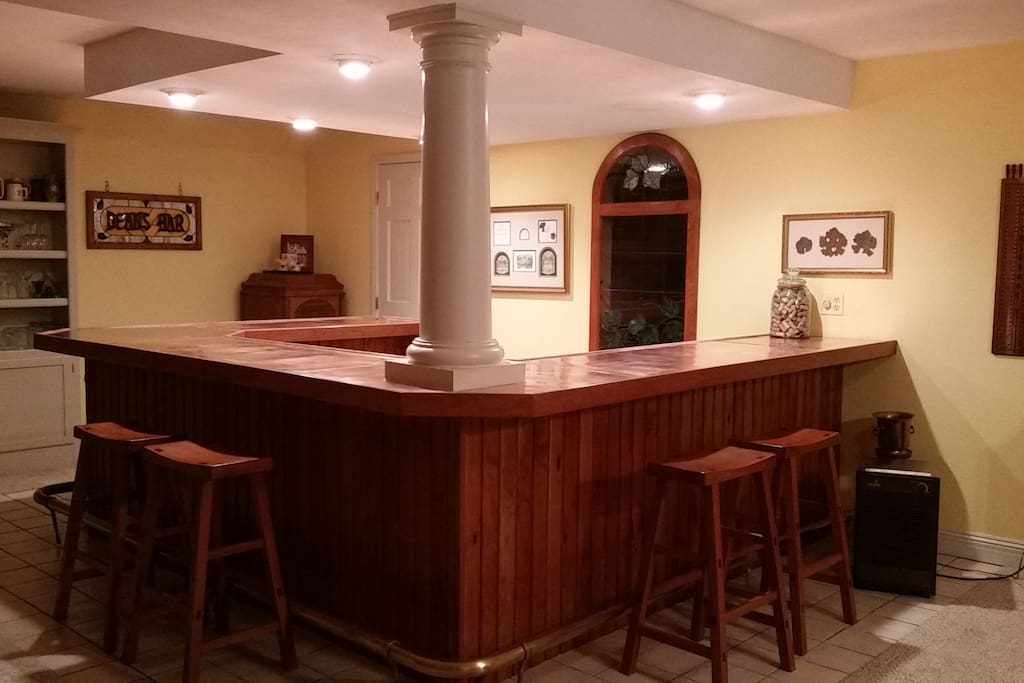 Downstairs Guest Suite - large copper top bar, wine cellar, computer work center adjacent to private bedroom & bath.  Perfect for relaxing at the end of the day with friends or family.