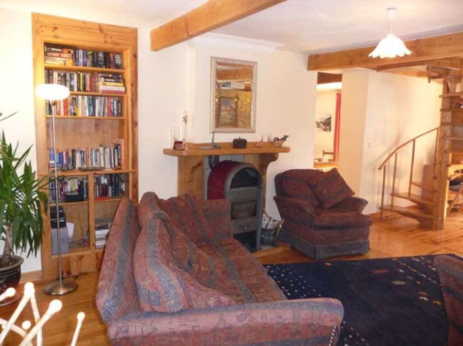 The lounge with wood burningstove, home cinema, bar and internet access,