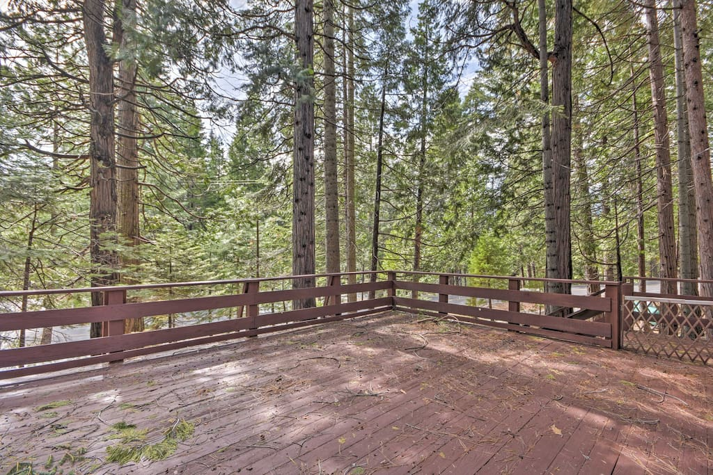 The large private deck provides ample space for everyone to enjoy the great outdoors.