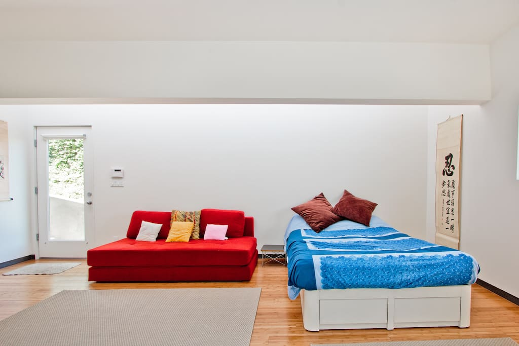 Convertible couch on the left becomes a full sized bed or two twins and comfy queen size bed on the right.