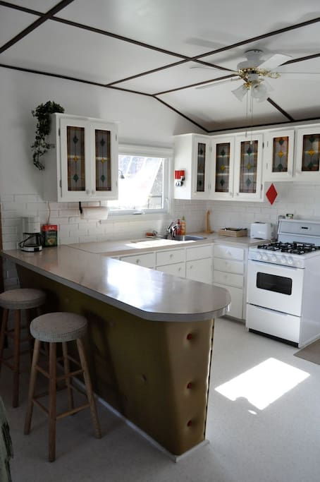 Bright sunny kitchen with gas stove