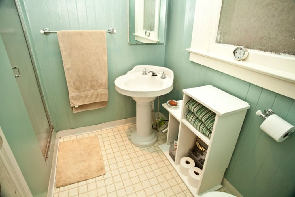 this is a shared bathroom, but it's directly outside your door.