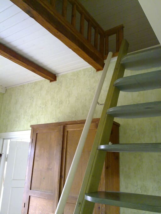 The stairs to the loft with 120 cm wide mattress in the smaller bedroom