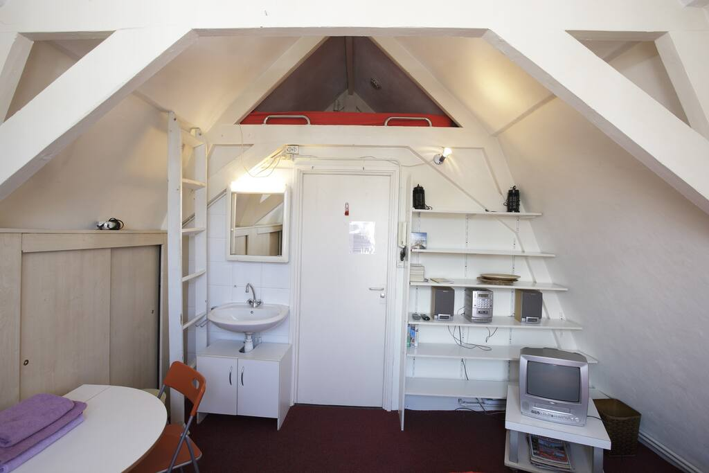 Attic (4th) floor private room with SHARED shower, toilet and kitchenette.