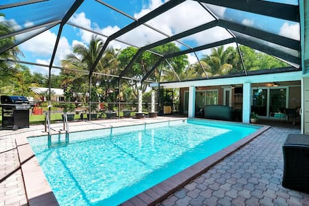 Spacious Waterfront Pool Home w/ 2 Queen Bedrooms