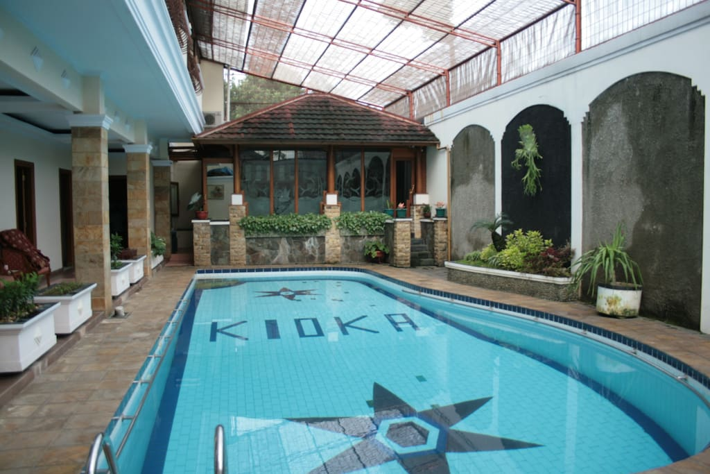 Swimming Pool Infront of Some Room