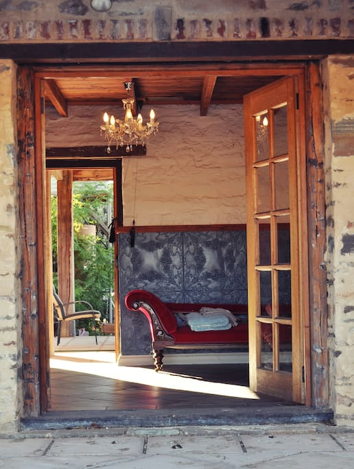 French doors lead out of the bathroom into a private courtyard