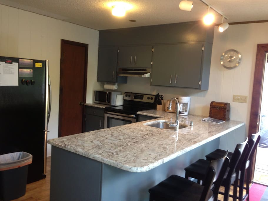 Main level includes open plan kitchen w/ 3 seat bar and brand new appliances