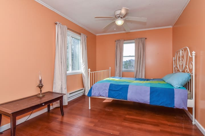 Bright main bedroom with queen bed