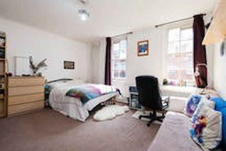 Huge room, amazing location! Long stays welcome.