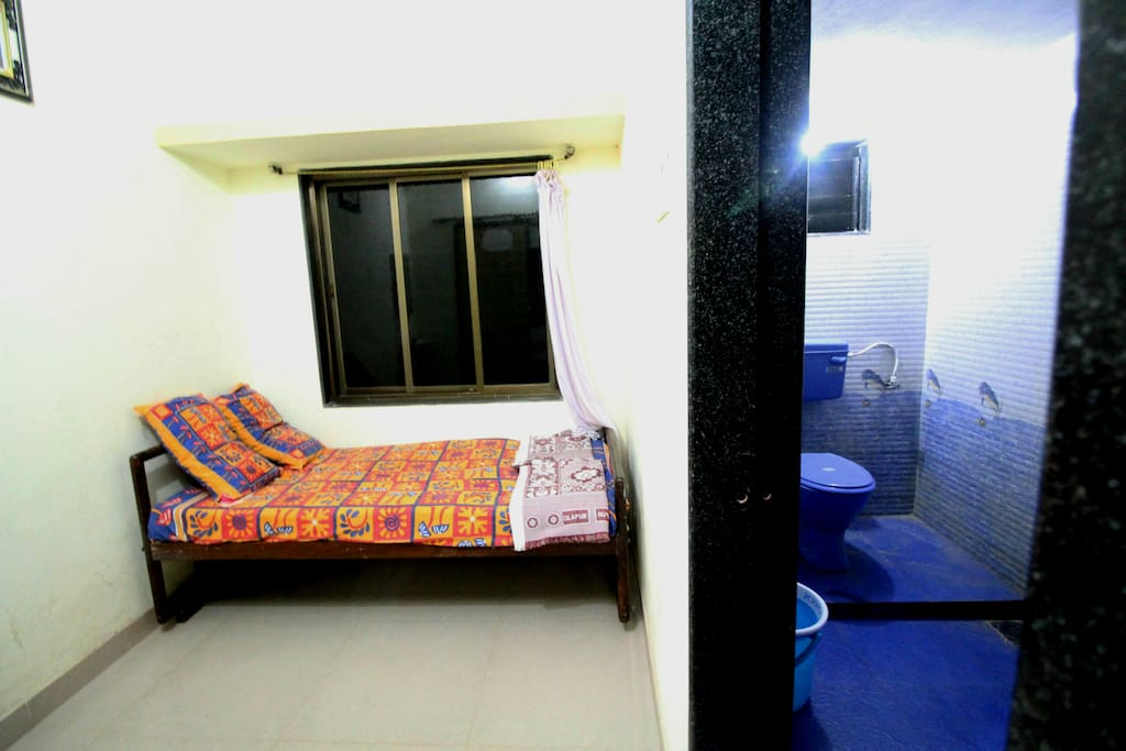 image of 1 single bed which is kept in room no 1