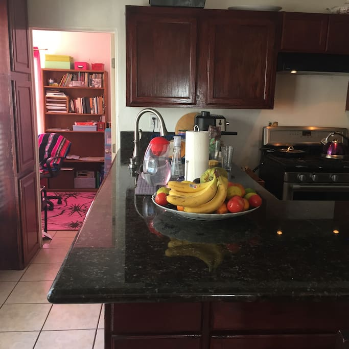 Kitchen with plenty of amenities including an expresso machine