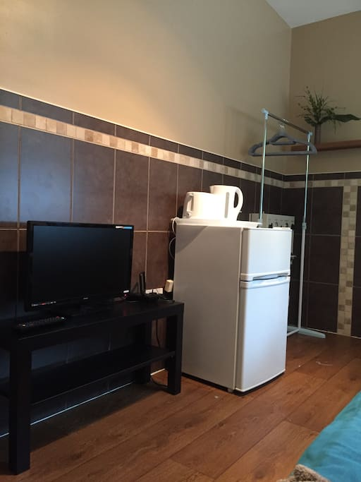 Smart TV in your room, kettle, toaster, fridge freezer and rail.