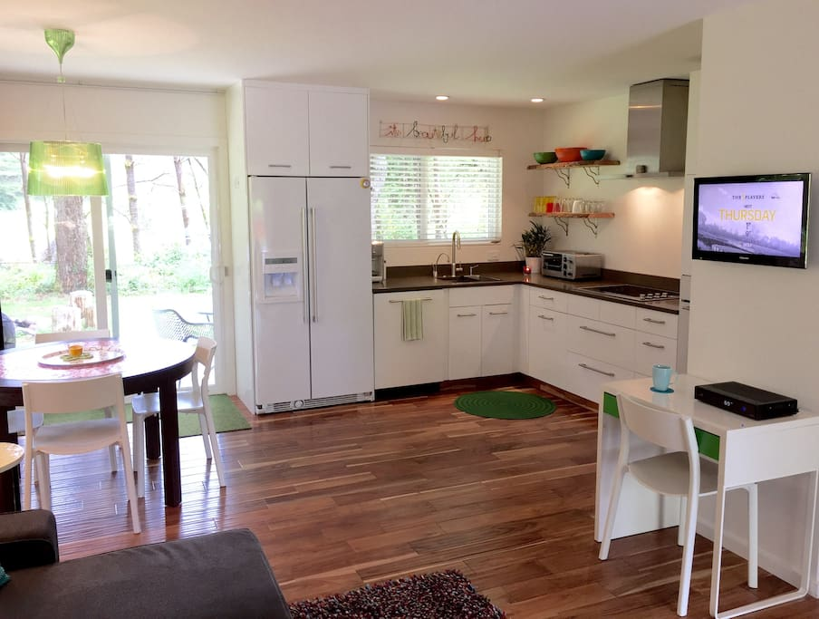 View from living area into kitchen/dining area - unobstructed views onto back yard/patio and golf course.  You're not staring into another house or yard.  Spectrum cable with built in DVD.