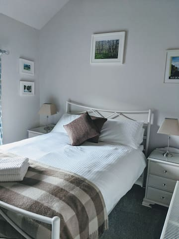 Private en-suite double room with fell views.