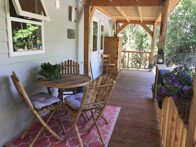 The porch is nice and cool during a hot summer day and sunny in the evening. It is 11 meters long and 2 meters wide.